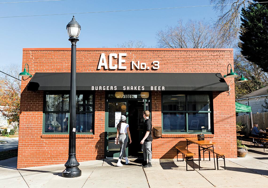 Customers walk into front doors of ACE No. 3.