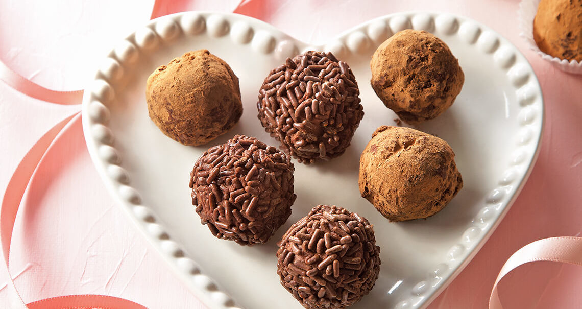 Chocolate truffles on a heart shape plate.