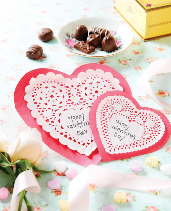 Valentine's Day heart shaped cards with candy and sweets.