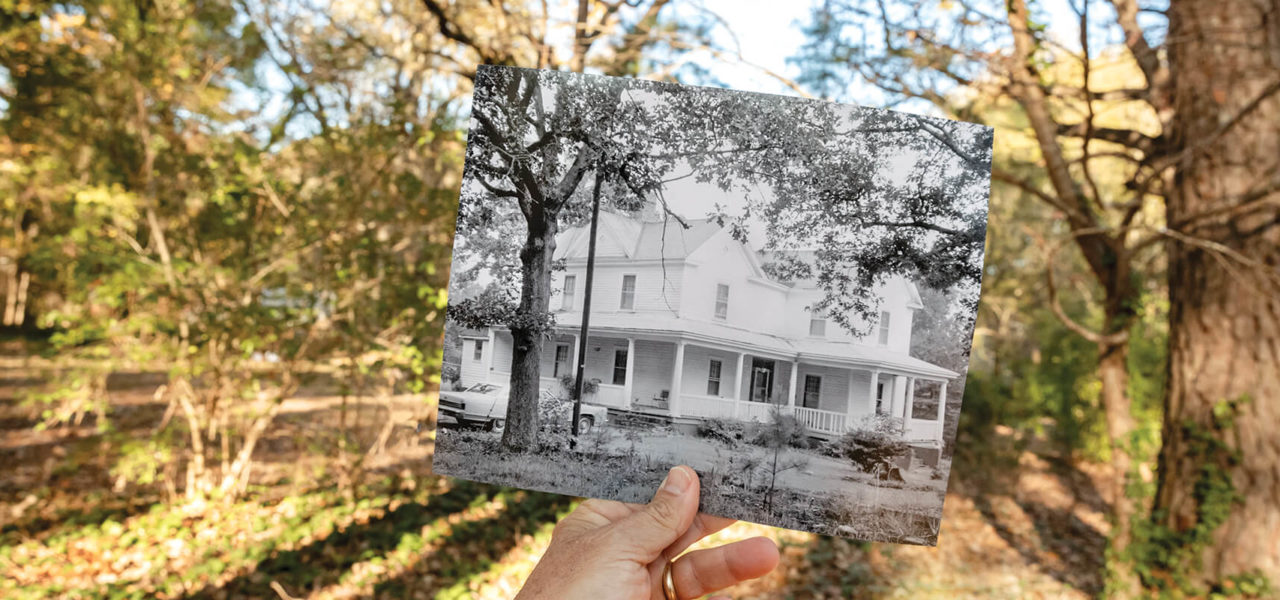 And old black and white photo of Latta University held in front of the original location.
