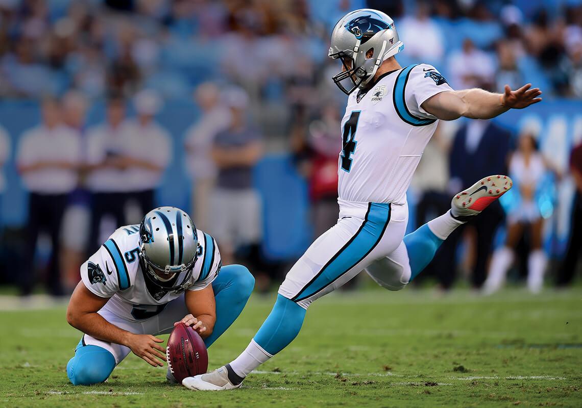 Carolina Panthers kicker Joey Slye goes for a punt.