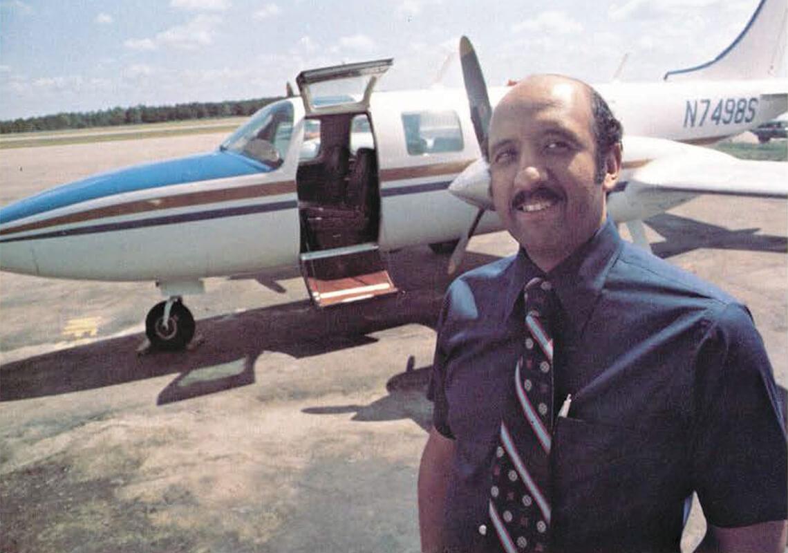 Warren Wheeler stands in front of one of his own plants in 1977.