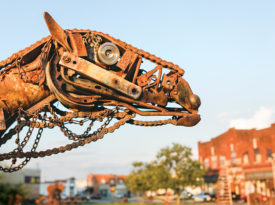 Scrap metal camel sculpture.