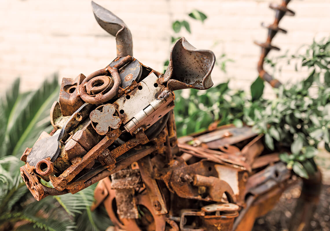 Close-up of scrap metal dog sculpture.
