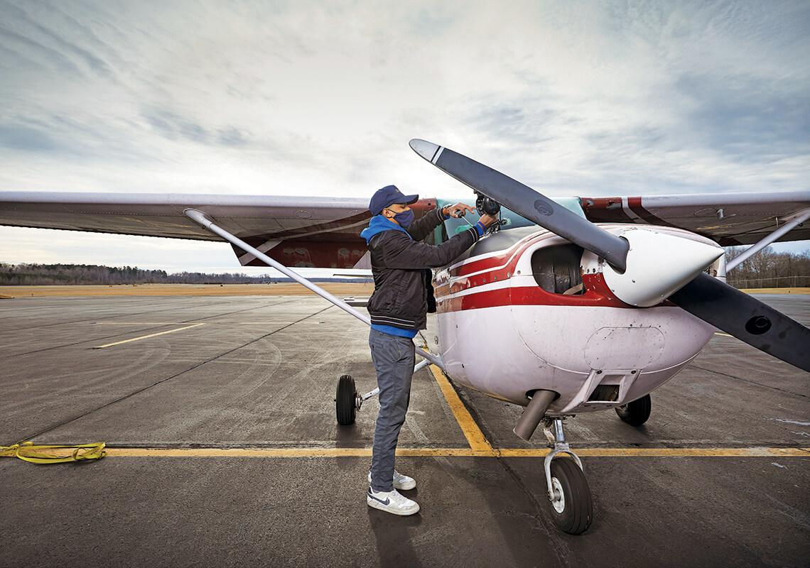 Ellis Woodyard checks the plane.