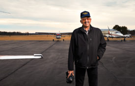Warren Wheeler stands on the tarmac.