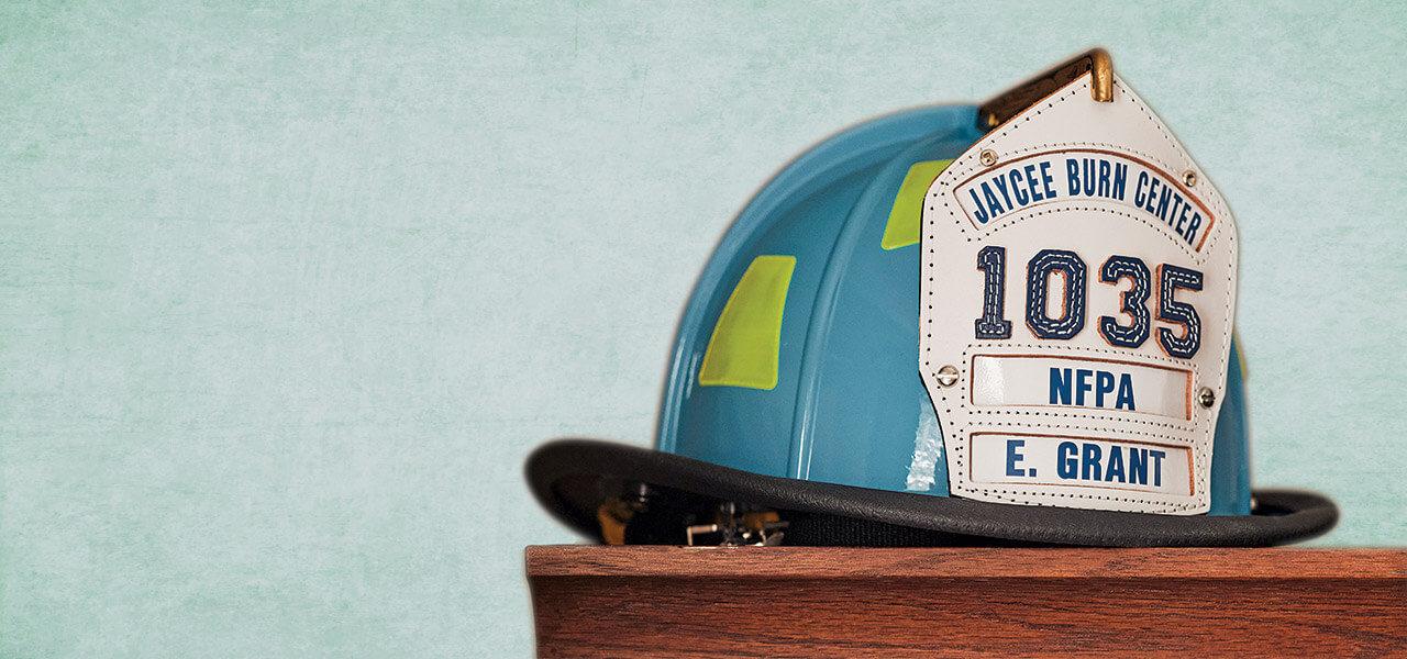 Ernest Grant's firefighter helmet sits atop wooden furniture.